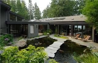 Oceanfront superb custom exec home wharf koi pond for Koi pond builders east rand