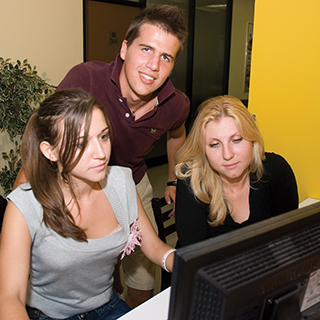 Students Studying At Computer