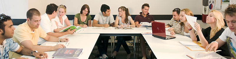 Students Around Classroom Tables